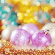 Stock Photo: Greeting card with Christmas balls in gold design
