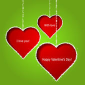 Abstract red hearts on green paper background. Valentines day gr — Stock Vector