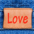 Closeup jeans leather label with text Love — Stock Photo