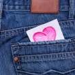 Valentine's day card in jeans pocket — Stock Photo #19318527