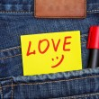 Valentine's day card in jeans pocket — Stock Photo