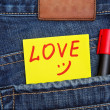Valentine's day card in jeans pocket — Stock Photo #19318531