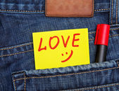 Valentine's day card in jeans pocket — Stock Photo