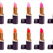 Photo: Beautiful lipsticks isolated on white background