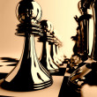 Chessmen of dark color on checkered board - Stock Photo