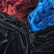 Blue red and black glossy velvet is formative folds and light-shadow picture — Stock Photo