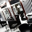 Interior of luxury modern hairdressing salon in pin-up style - Stock Photo
