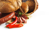 Maso a pšeničné produkty na bílém pozadí — Stock fotografie