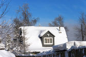 Snow-covered roof of a village house — Stock Photo