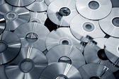 Technological background of the many new CDs — Stock Photo