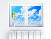 Window with cloudy sky and flowers on sill — Stock Photo