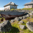 Stock Photo: Old boat and stone houses.