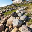 Stock Photo: Stone house on rocky shore.