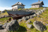 Old boat and stone houses. — Stock Photo