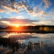 Sunrise over the river. - Stock Photo