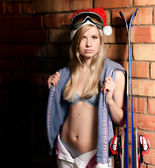 Young sexy blonde with skis. — Stock Photo