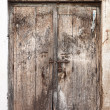Royalty-Free Stock Photo: Old dilapidated wooden door.