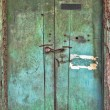 Stock Photo: Old dilapidated wooden door.