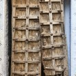 Old dilapidated wooden door. — Foto de stock #18837571