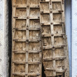 Old dilapidated wooden door. — Stock Photo