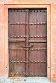 Old brown wooden door. — Stock Photo