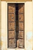 Old dilapidated wooden door. — Stock Photo