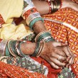 Hands of a young Indian woman adorned with traditional bangles and mehndi.  - Stock Photo