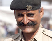 Portrait of a police officer on the Pushkar fair — Stock Photo