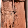 Stockfoto: Old dilapidated wooden door.