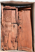 Old dilapidated wooden door. — Stockfoto