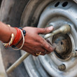 Man changing the car wheel on the road, close up — Stock Photo