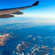 Air travel over the mountains — Stock Photo