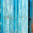 Old blue wooden shutters — Stock Photo