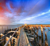 Old wooden pier at sunset. — Stock Photo