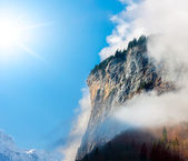 Sun, clouds and fog in the Bernese Alps. — Stock Photo