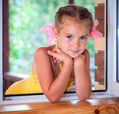 A girl in the window. — Stock Photo