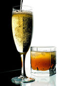 Glass of champagne and whisky with ice. — Stock Photo
