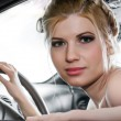 Young Woman Sat In The Drivers Seat of Her Car — Stock Photo