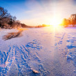 Sunrise over the frozen river - winter landscape — Stock Photo
