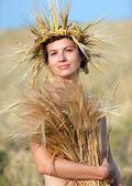 Woman in field of wheat — Stock Photo