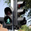 Isolated green pedestrians traffic light  — ストック写真