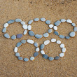 Symbol of olympiad from small stone — Stock Photo #37331769