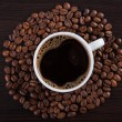 Cup of coffee with beans — Stock Photo #22075561