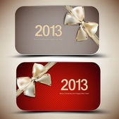Collection of gift cards with ribbons. 2013 — Stockvector