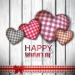 Red cloth handmade hearts on wooden background. Valentines day. — Imagen vectorial