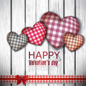Red cloth handmade hearts on wooden background. Valentines day. — Stock Vector