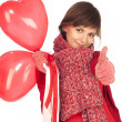 Girl with red heart balloon — Stock Photo #2255946