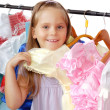 Little girl in shop of dresses. — Stock Photo #13463161