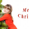 Girl embraces a green pine on white background — Stock Photo