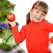 Little girl decorates a fur-tree. — Foto de Stock